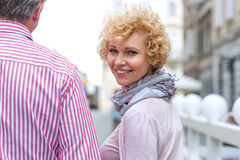 Portrait of happy middle-aged woman with man outdoors Royalty Free Stock Images