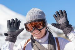 Portrait of a happy middle aged woman after skiing. Stock Photos