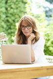 Woman with laptop outdoor Stock Photo