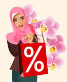 Portrait of happy modern arabic woman with red shopping bag. Royalty Free Stock Photos