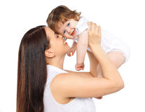 Portrait happy mom and baby on a white background, family, tenderness
