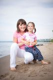 Portrait of happy mom and daughter Stock Photos