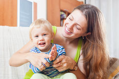 Portrait of happy mom with toddler Stock Photos