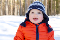 Portrait of happy 18 months baby in winter forest royalty free stock photography