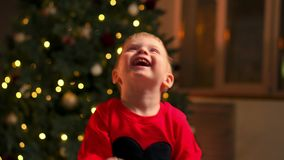 Portrait of happy mother and adorable baby celebrate Christmas. New Year`s holidays. Toddler with mom in the festively stock video
