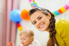 Portrait of happy mother at babies birthday party Royalty Free Stock Image
