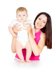 Portrait of happy mother with a baby Stock Images