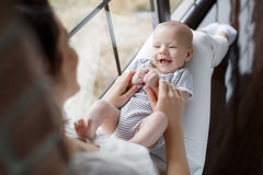 Portrait of happy mother and baby. Royalty Free Stock Images