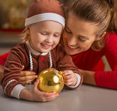 Portrait of happy mother and baby with christmas ball Royalty Free Stock Images
