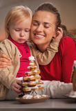 Portrait of happy mother and baby and cookie christmas tree Stock Photos