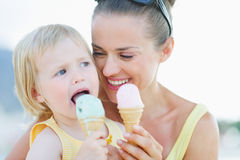 Portrait of happy mother and baby eating ice cream Stock Photos