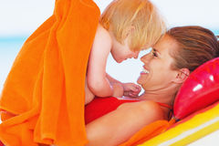 Portrait of happy mother and baby enjoying vacation Royalty Free Stock Images