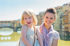 Portrait of happy mother and baby girl in florence, italy Royalty Free Stock Images