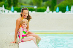 Portrait of happy mother and baby girl near pool Stock Images