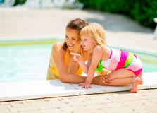 Portrait of happy mother and baby girl in pool Stock Photos