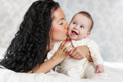 Portrait of happy mother and baby at home Stock Images