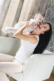Portrait of happy mother and baby at home Royalty Free Stock Images