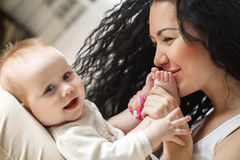 Portrait of happy mother and baby at home Stock Image