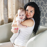 Portrait of happy mother and baby at home Royalty Free Stock Photography