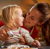 Happy mother and baby making christmas cookies in ki Stock Photo