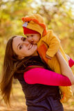 Portrait of happy mother and baby in the park.Family child outdo royalty free stock image