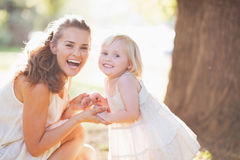 Portrait of happy mother and baby in park Royalty Free Stock Photography
