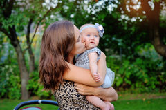 Portrait of happy mother and baby playing outdoors Stock Photos