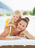 Portrait of happy mother and baby at poolside Royalty Free Stock Images