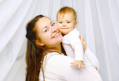 Portrait happy mother and baby together Stock Images