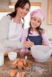 Portrait of a happy mother baking with her daughter Royalty Free Stock Photos