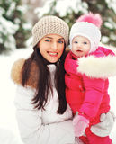 Portrait of a happy mother with child outdoors in the winter Stock Images