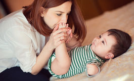Portrait of happy mother and child playing Royalty Free Stock Photos