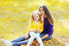 Portrait happy mother with child together in warm sunny autumn Royalty Free Stock Image