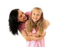 Beautiful young mother and cute charming daughter hugging and playing together. Happy loving family royalty free stock image