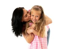 Beautiful young mother and cute charming daughter hugging and playing together. Happy loving family stock images