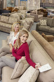 Portrait of a happy mother and daughter in furniture store Stock Image