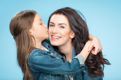 Portrait of happy mother and daughter hugging in studio Royalty Free Stock Photos