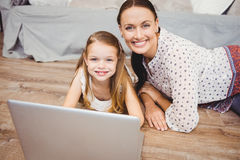 Portrait of Happy mother and daughter with laptop Stock Images