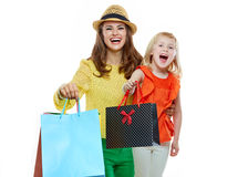 Portrait of happy mother and daughter showing shopping bags Royalty Free Stock Photos