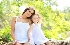 Portrait of happy mother and daughter together outdoors Stock Photos