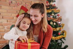 Portrait of happy mother and her baby near Christmas tree Stock Photography