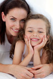 Portrait of a happy mother and her daughter. Smiling at the camera Stock Image