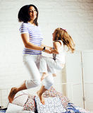 Portrait of happy mother and her daughter playing in bad, lifestyle people concept Stock Photo