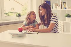 Portrait of happy mother and her pretty little daughter at the t royalty free stock photography