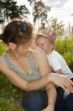 Mother playing with son in meadow Stock Images
