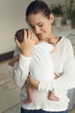 Portrait of happy mother holding newborn baby boy Royalty Free Stock Photo