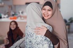Mother hug her daughter during ramadan visit