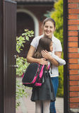 Portrait of happy mother meeting her daughter after in school in Royalty Free Stock Photos