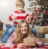 Portrait of happy mother and son on the background of the Christmas tree in new year room. The idea for postcards Royalty Free Stock Images