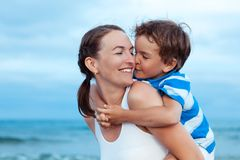 Portrait of happy mother and son at sea Stock Photo